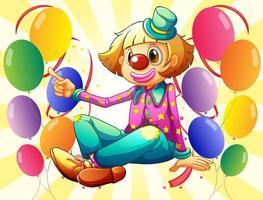 En kvinnlig clown som sitter mitt i ballongerna