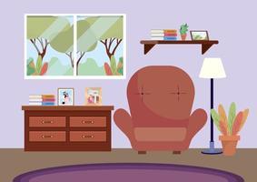 vardagsrum med stol och bilder i byrå