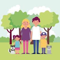 lächelnde Familie mit zwei Hunden und Kindern, die den Park genießen
