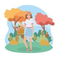 Frau mit Korb Essen und Weinflasche und Trauben vektor