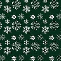 Schneeflocken auf grünem Hintergrunddesign
