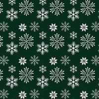 snöflingor på grön bakgrundsdesign