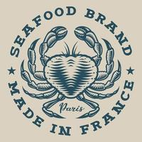 Nautisches Abzeichen mit einer Krabbe im gravierten Stil