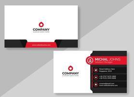 vitt visitkort med röda och svarta detaljer