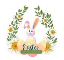 glad påskbild med kanin och blommig krans