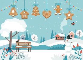 Weihnachtslandschaft und hängende Lebkuchenplätzchen