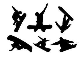 Silhuetter av snowboardåkare