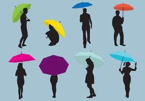 Frau und Mann Regenschirme Silhouetten vektor