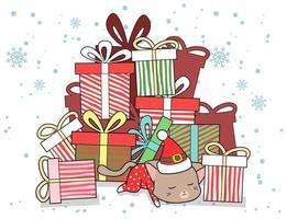Katze in der Weihnachtsmütze, die am Boden des Haufens der Geschenke schläft