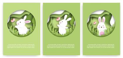 Papierschnitt-Kartensatz mit niedlichem Kaninchen vektor