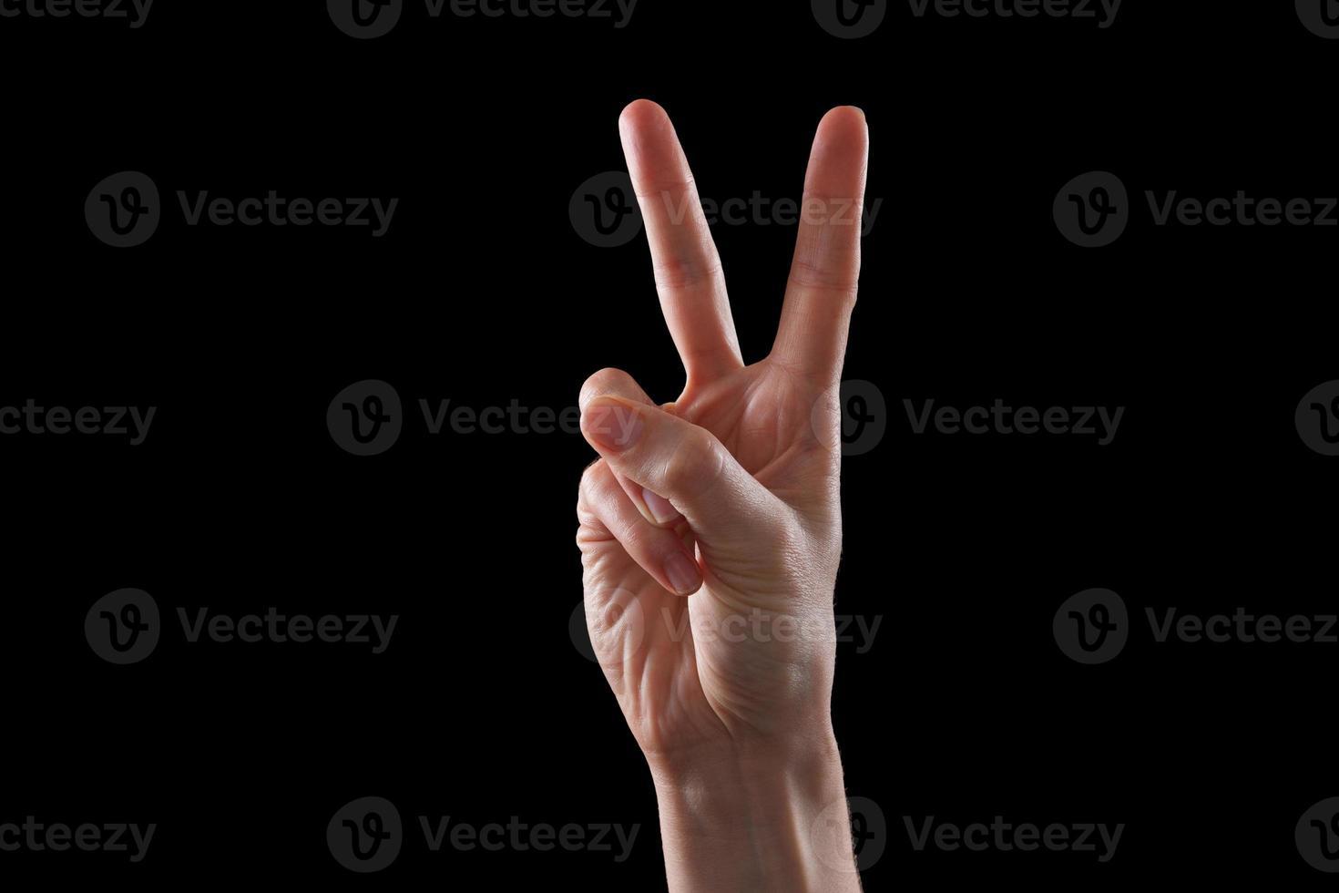 geste, la main de la jeune femme indique la direction ou les appareils tactiles photo