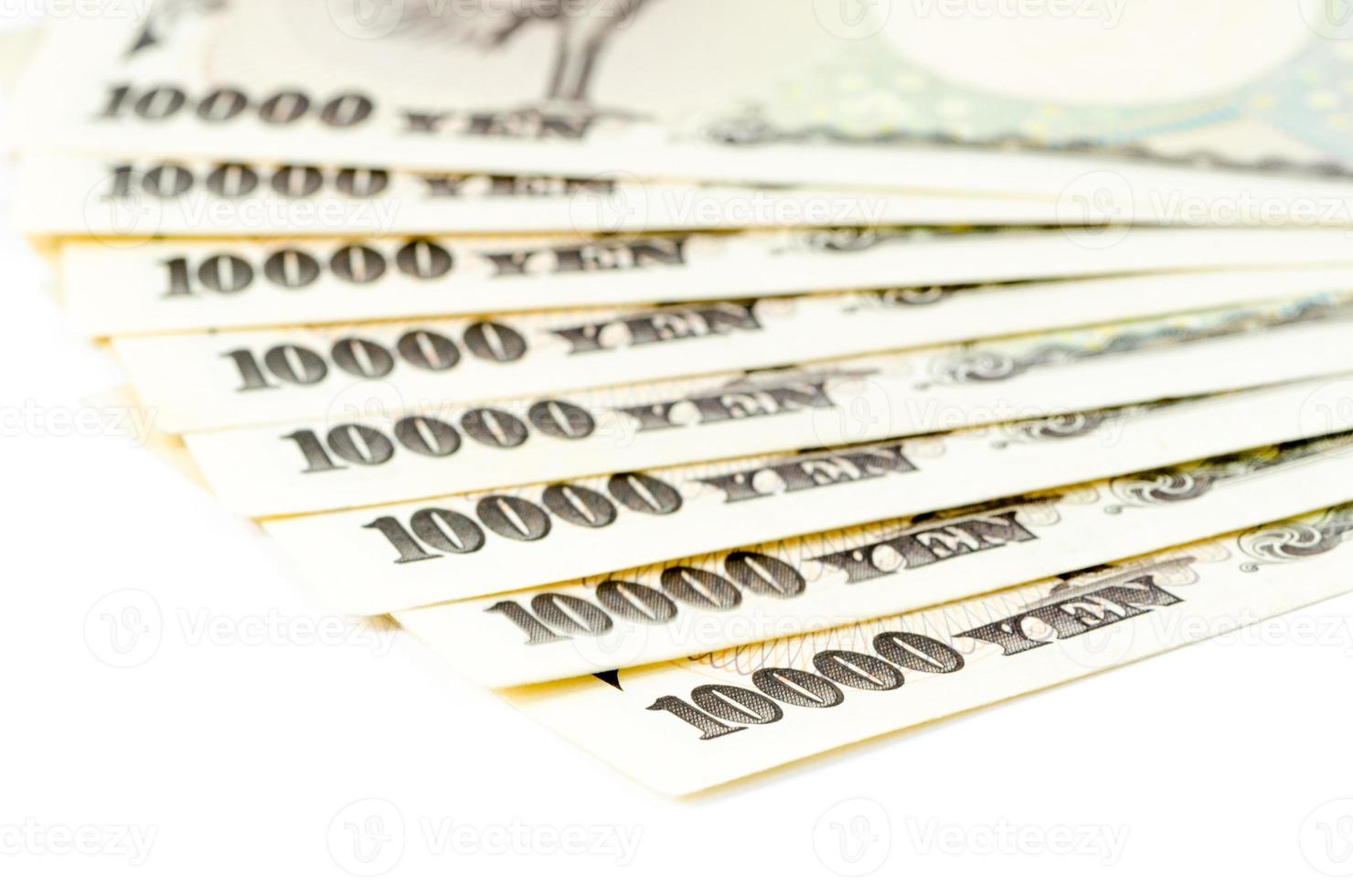 Cash yen japonais sur fond isolé photo