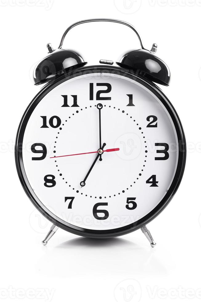 temps pour le travail - réveil indique sept heures photo