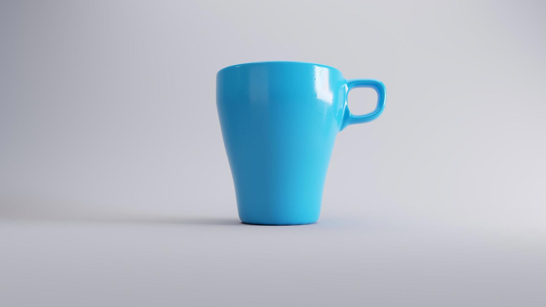 tasse à café bleue sur fond blanc photo