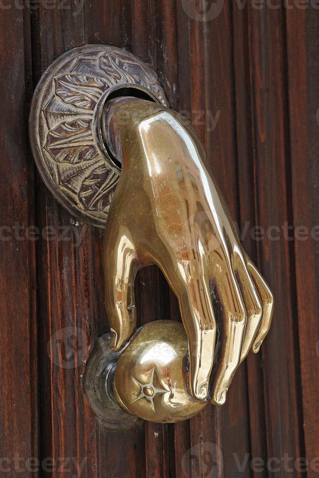 heurtoir de porte en cuivre poli photo