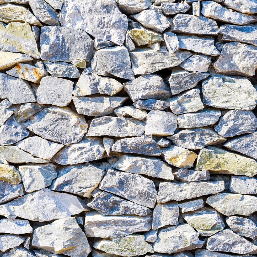 surface de mur en pierre fissurée avec du ciment photo