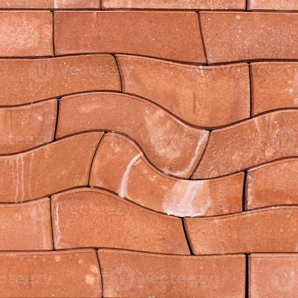 le mur de blocs orange pourrait être utilisé pour la texture de fond photo