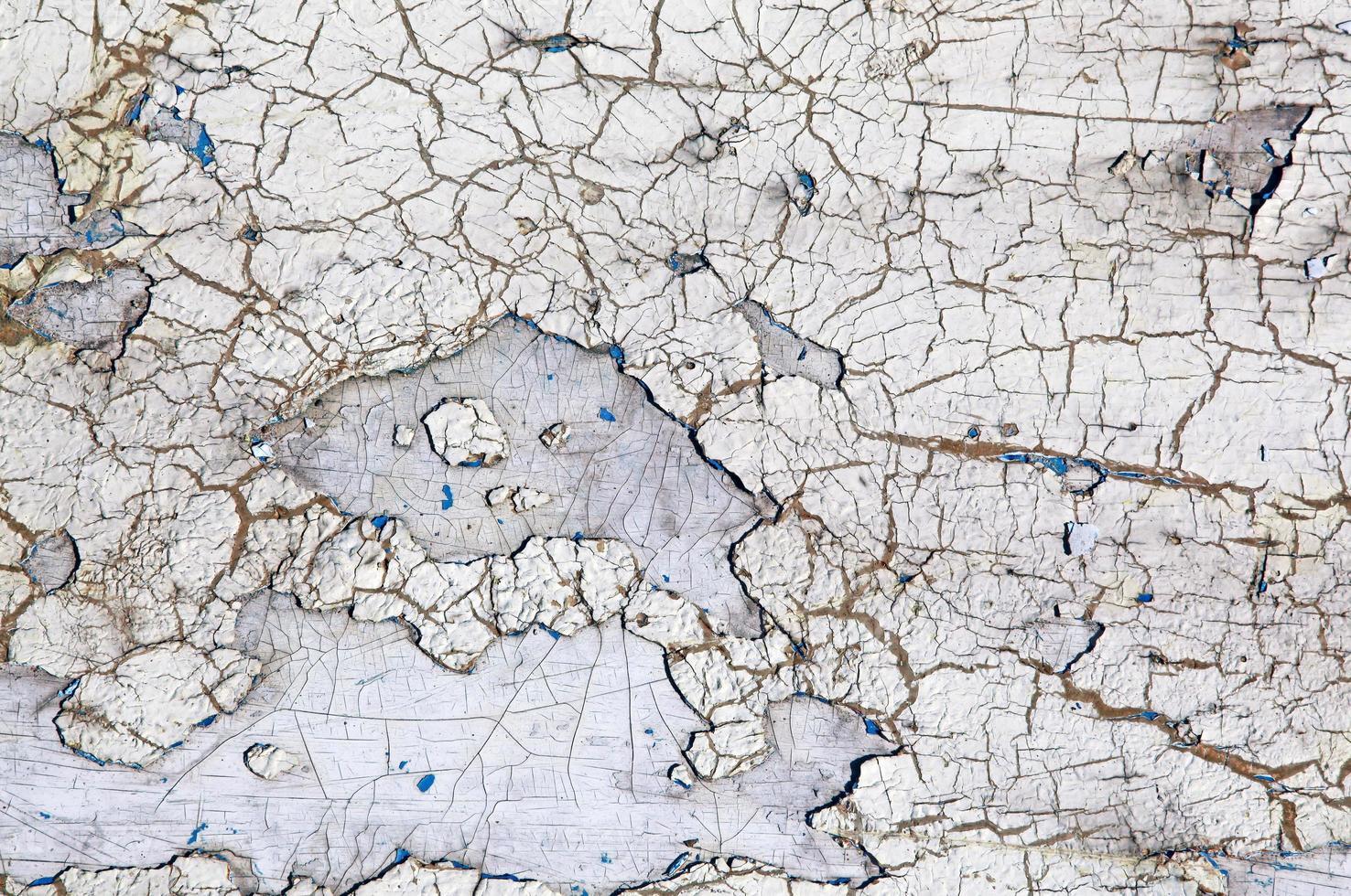 Mur avec fond de peinture écaillée blanc patiné photo