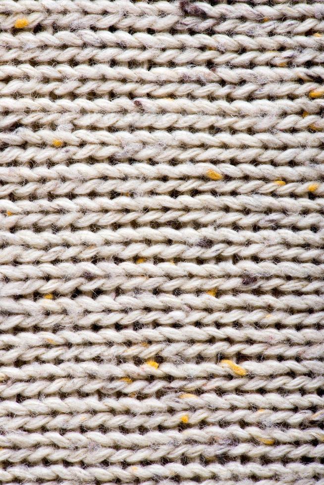 fond de texture de laine à tricoter blanc. photo