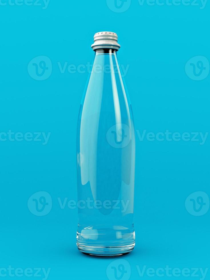 bouteille en verre transparent sur fond bleu photo