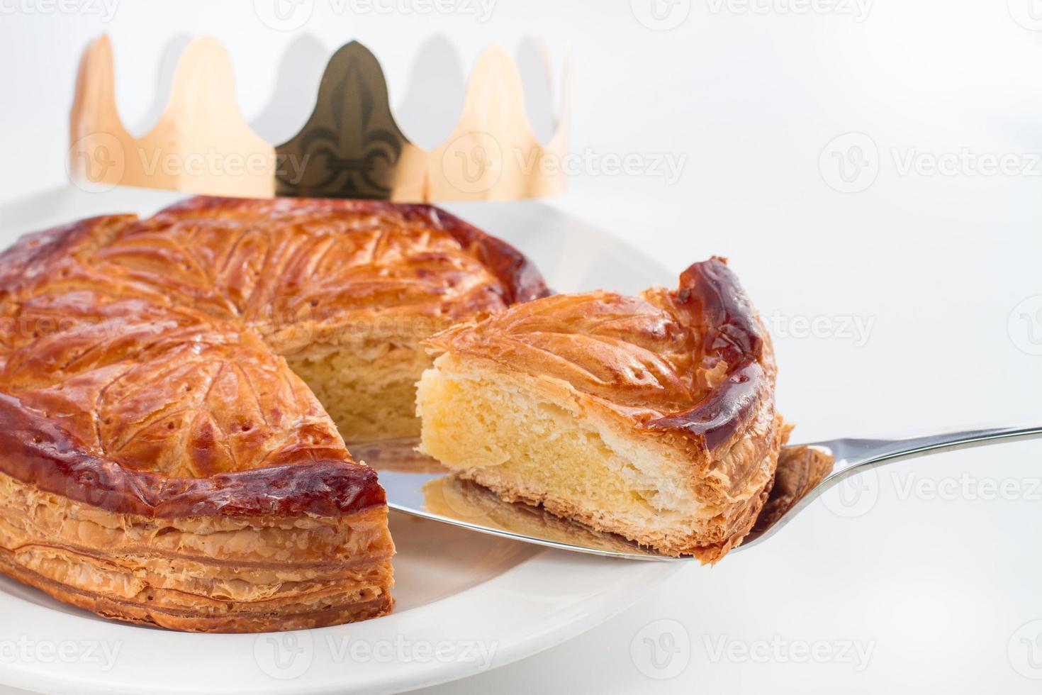 Close-up of epiphany king cake - galette des rois on white photo