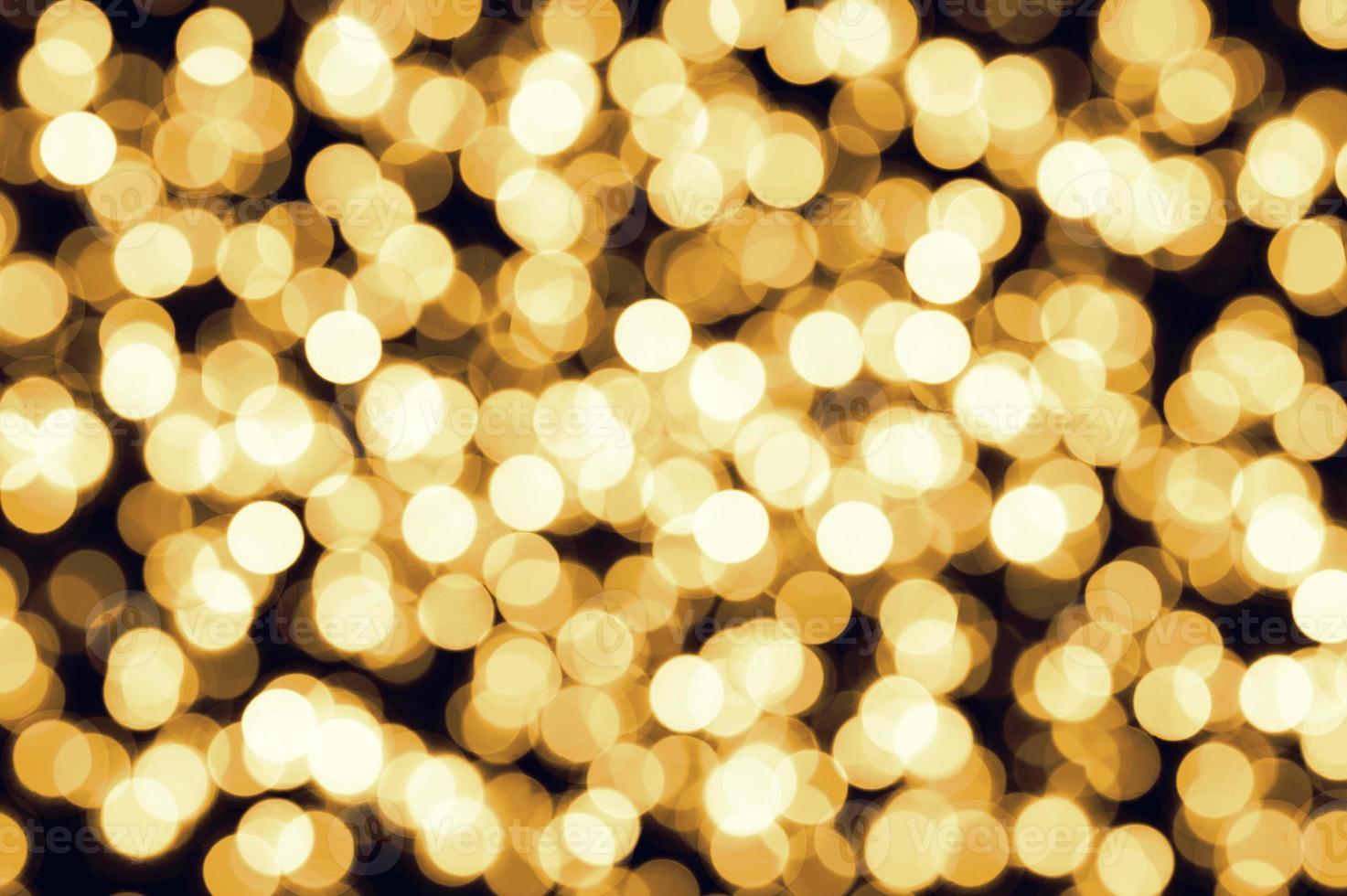 fond de lumières de Noël bokeh défocalisé jaune or photo