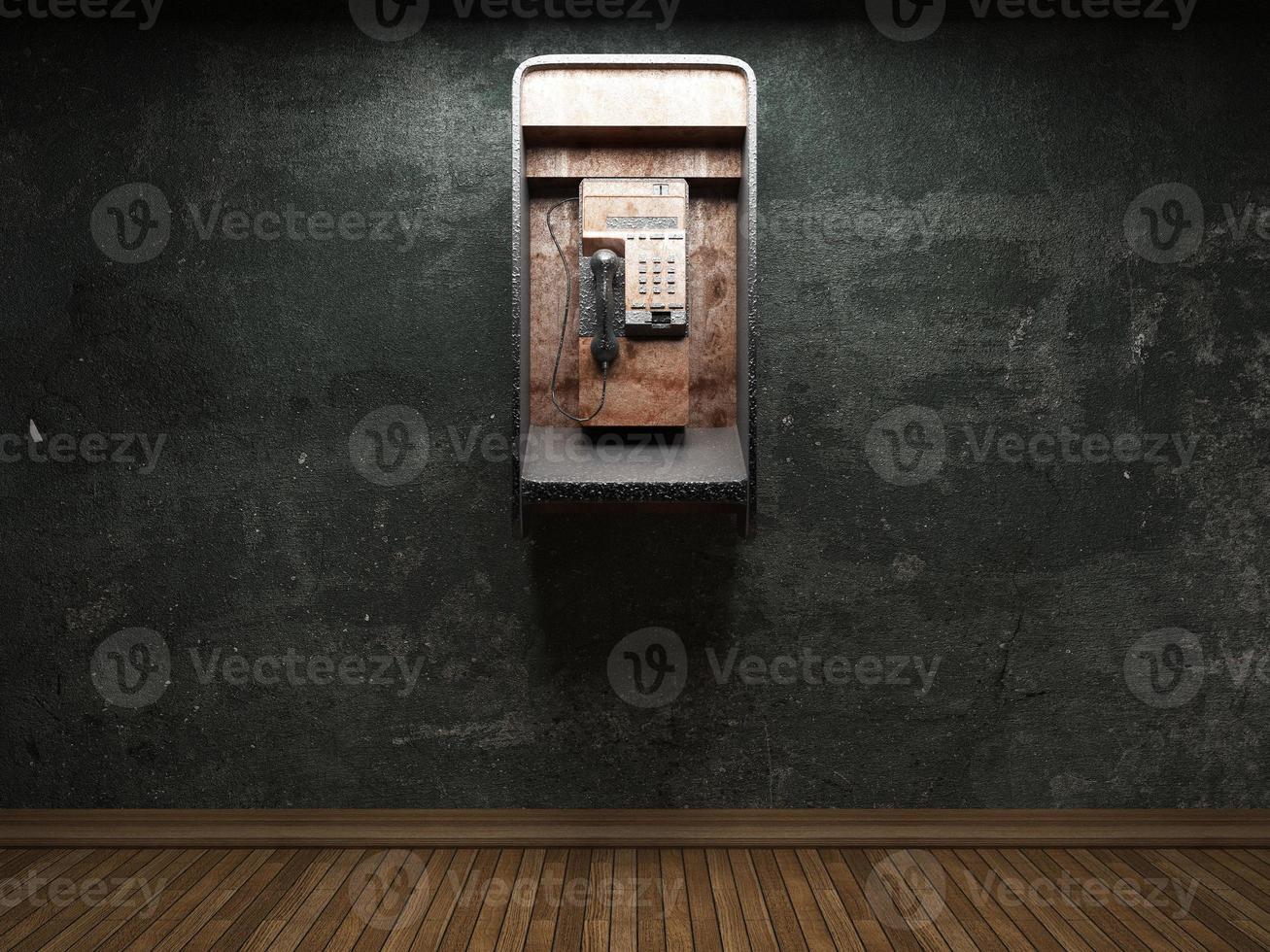 vieux mur de béton et cabine téléphonique photo