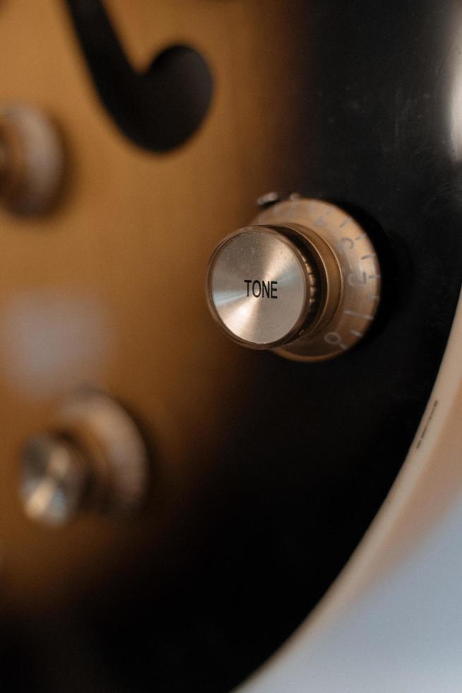 bouton de guitare doré photo