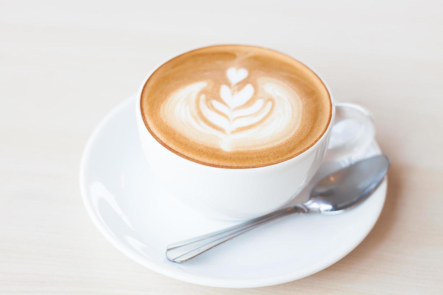 tasse à café avec art latte photo