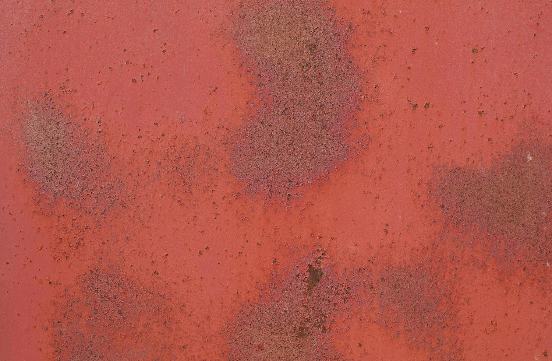 texture de mur minimaliste en acier oxydé rouge photo