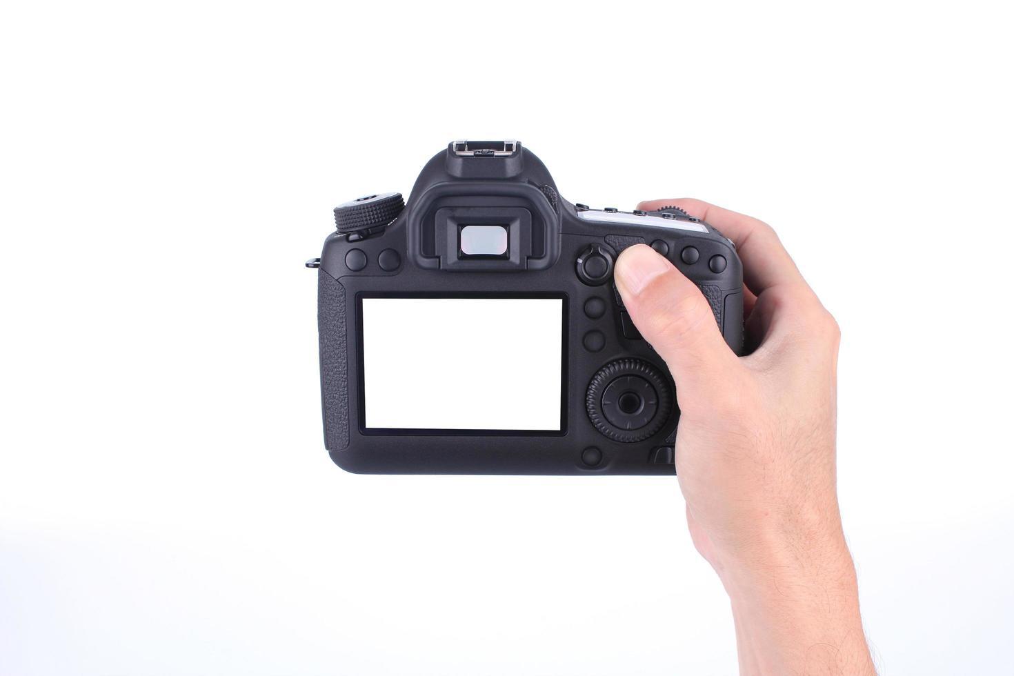 main tenant la caméra avec écran vide photo