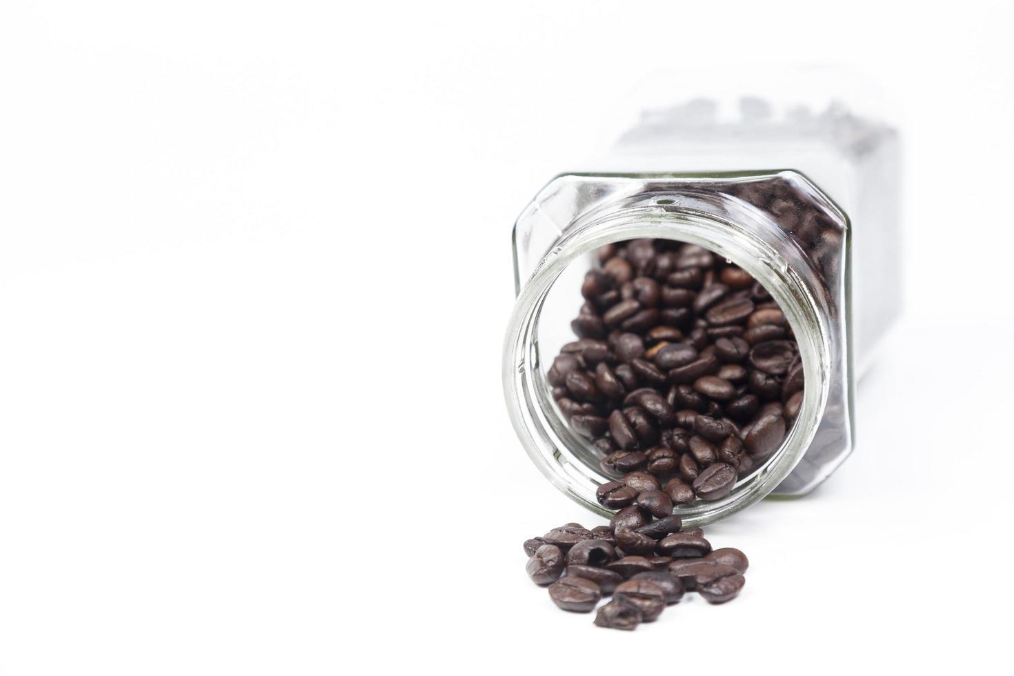 bouteille de grains de café photo