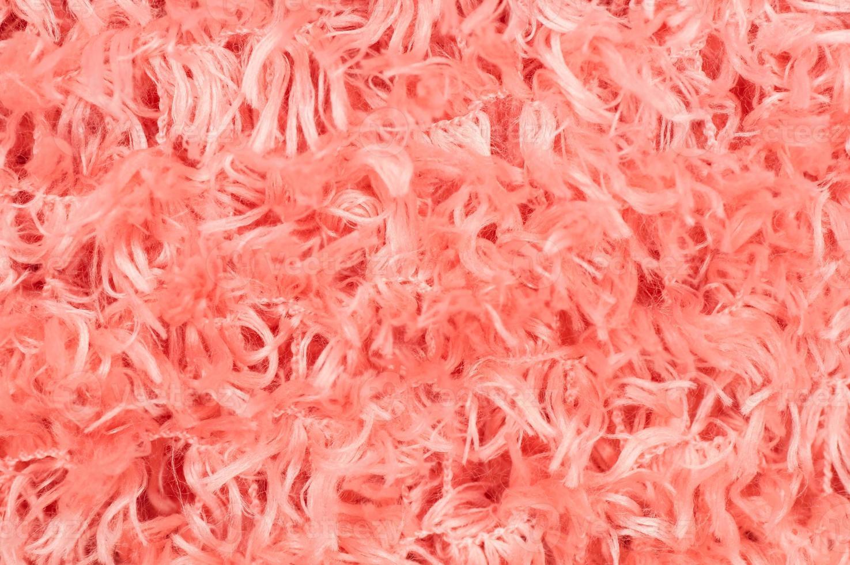 Close up de tapis en coton rose tendre photo