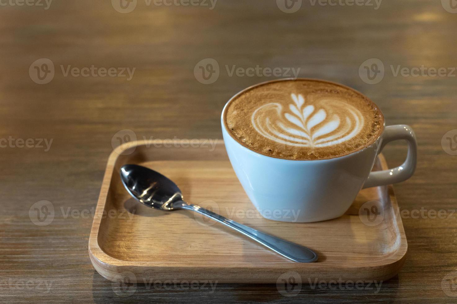 art latte dans une tasse de café photo