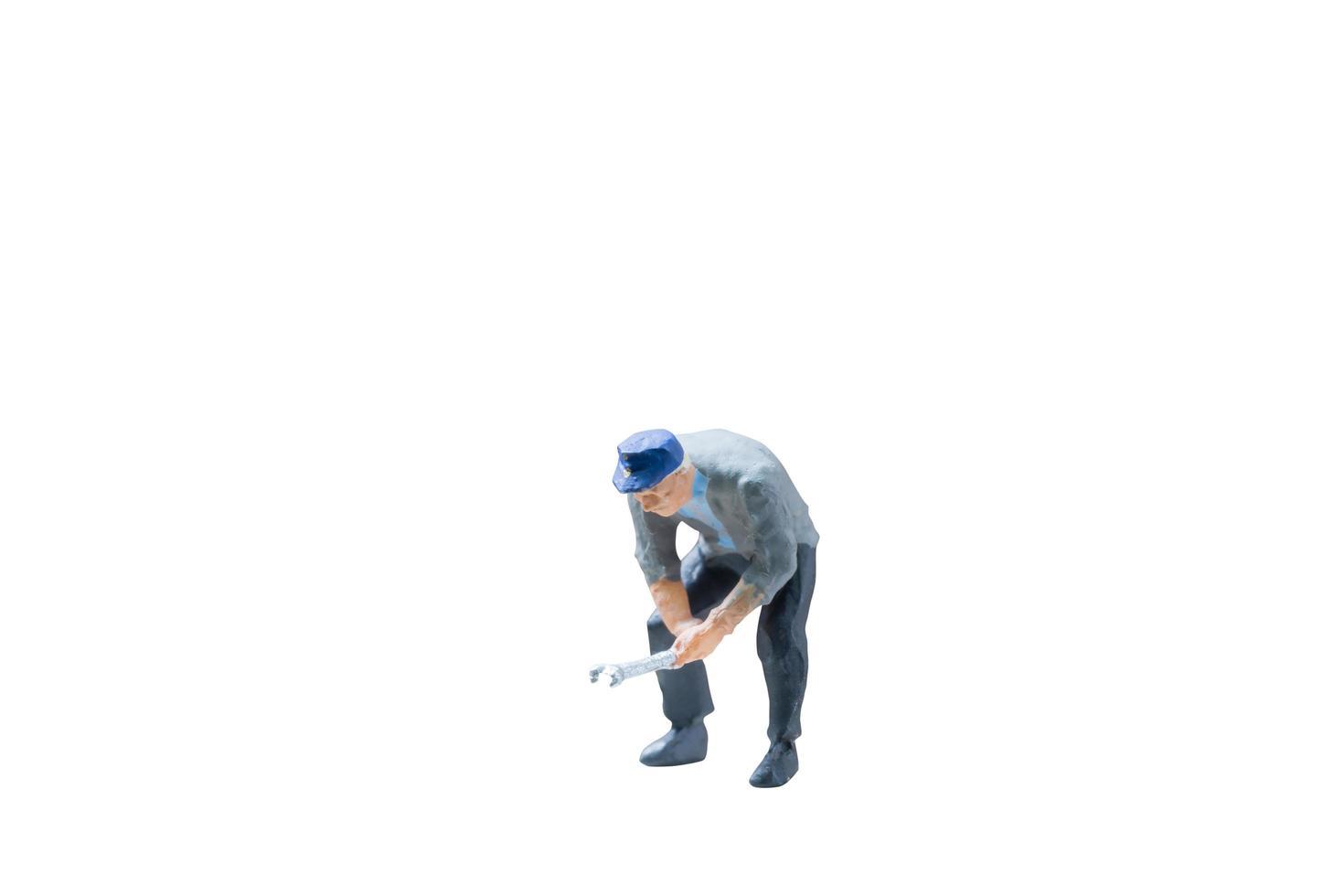 Concept de travailleur de la construction miniature isolé sur fond blanc photo