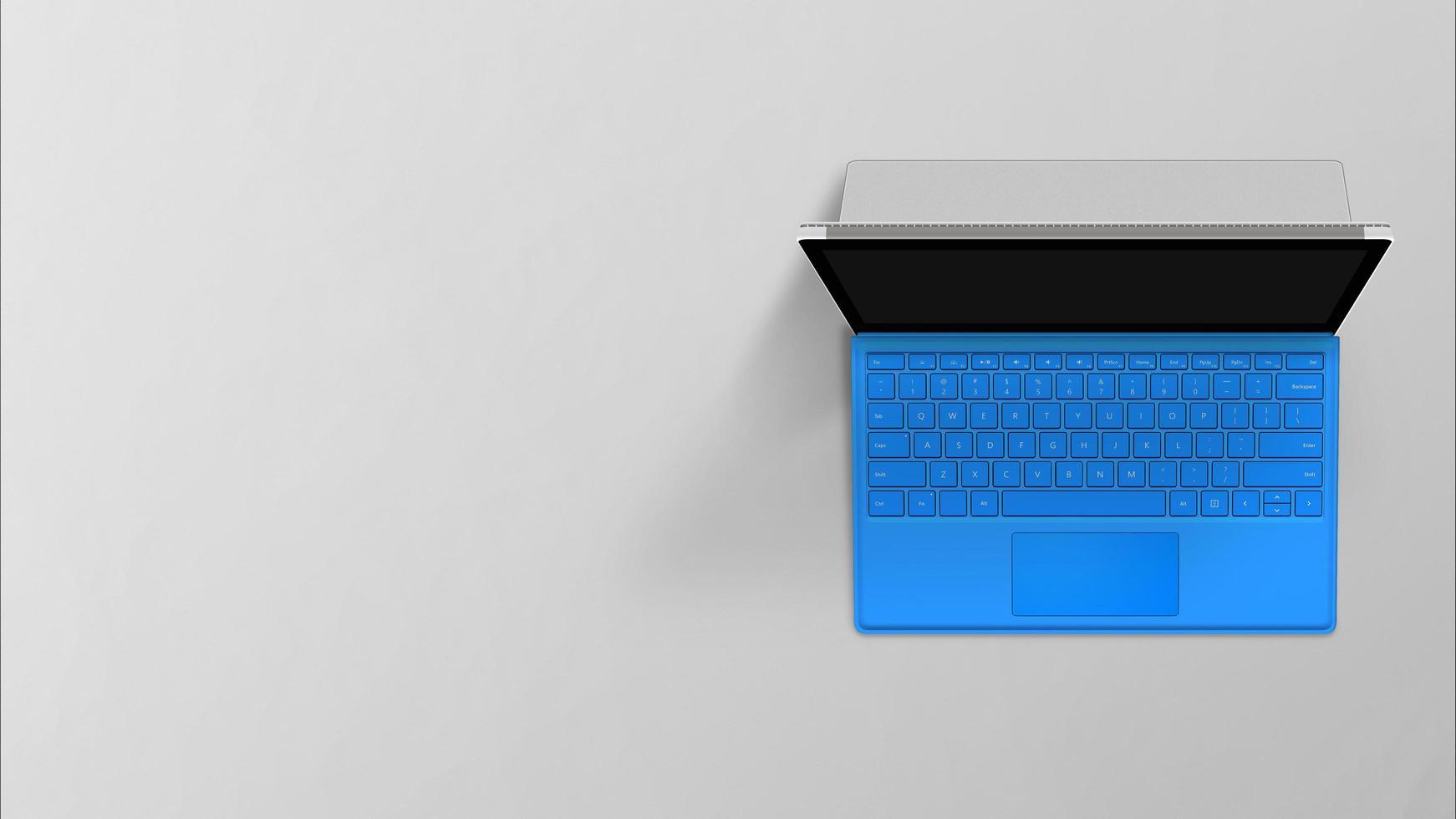 Vue de dessus de l'ordinateur portable ordinateur portable bleu tourné sur fond gris photo