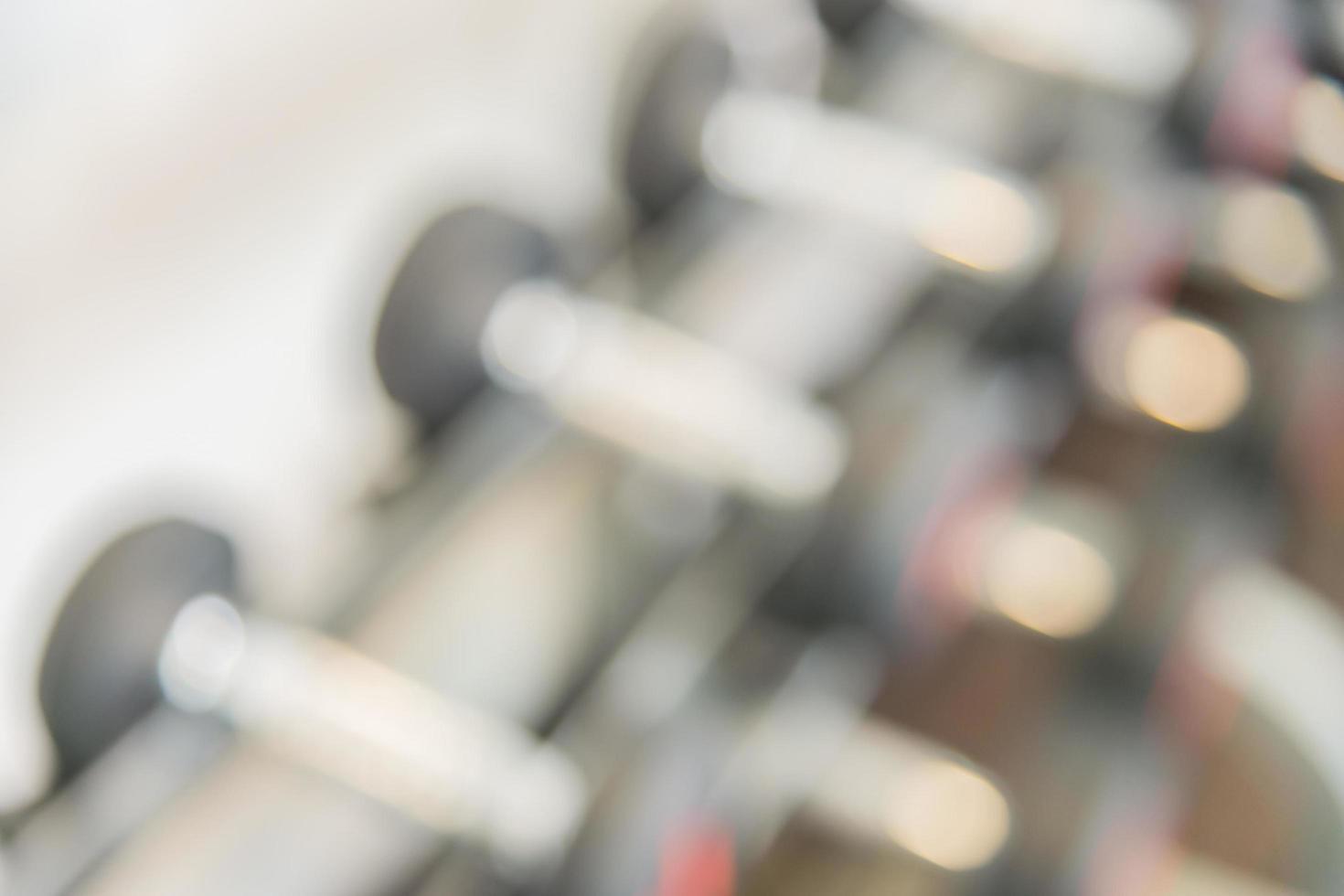haltères floues dans la salle de sport, arrière-plan photo