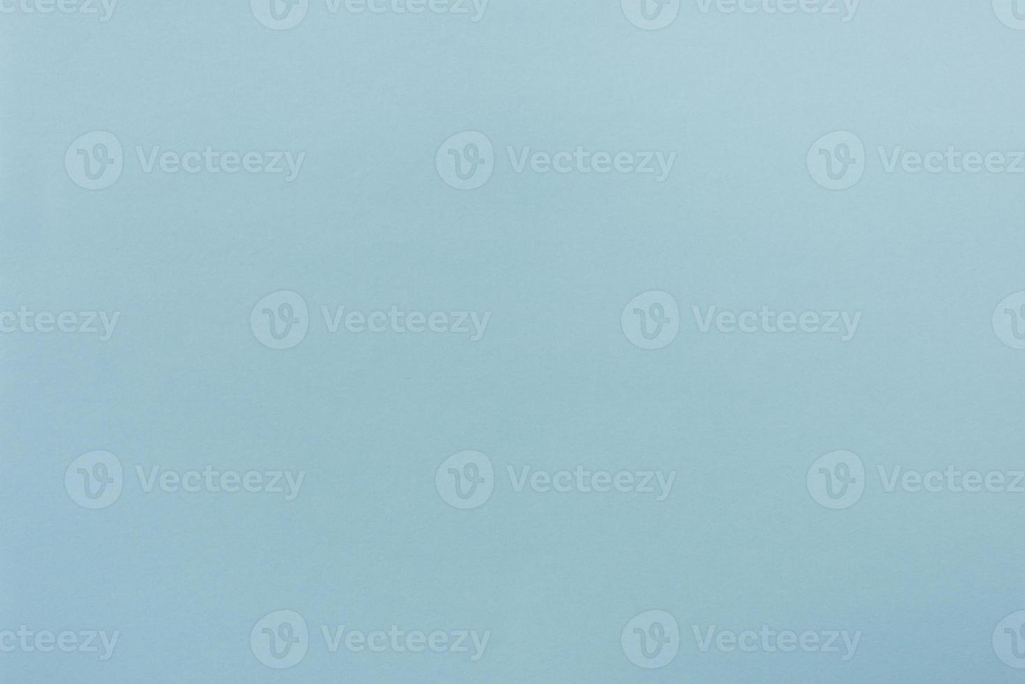 papier bleu avec une texture douce. fond simple. photo