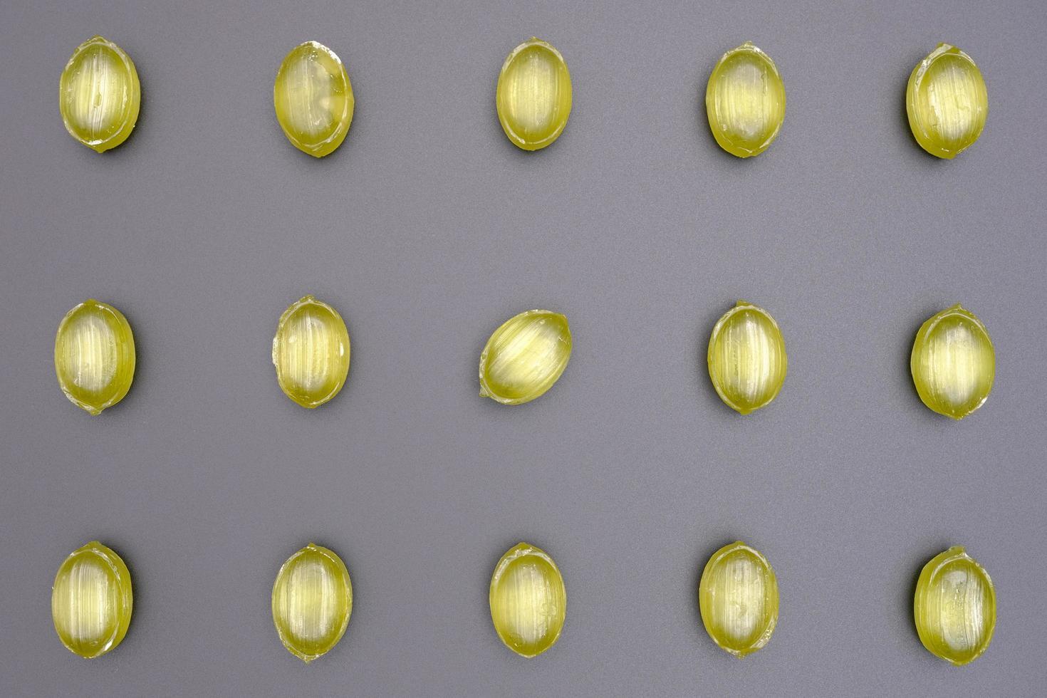 motif de bonbons au caramel brillant de forme ovale verte photo
