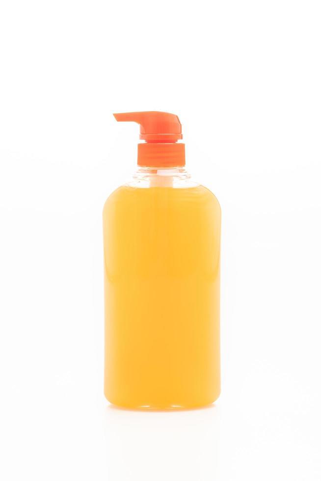 bouteille de savon liquide sur fond blanc photo