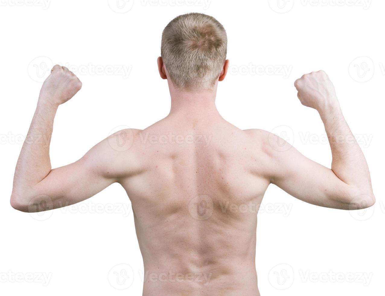 Homme debout avec son dos sur un fond blanc photo