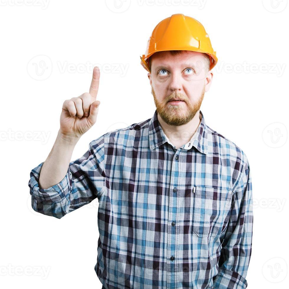 homme dans un casque montrant son index vers le haut photo