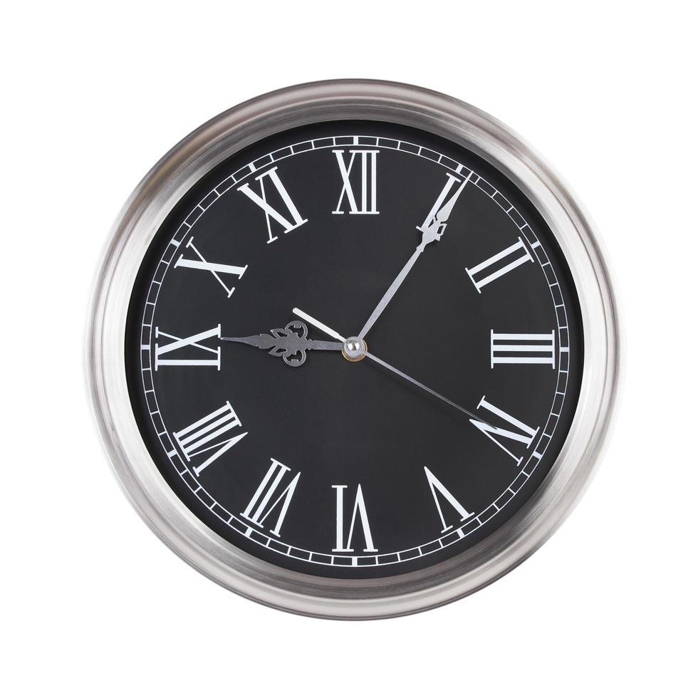 neuf heures cinq sur un cadran d'horloge photo