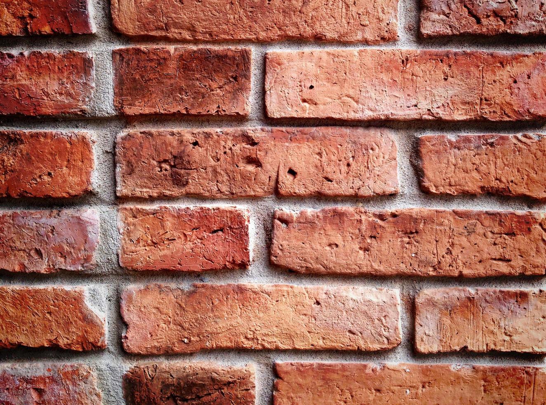 texture de mur de brique ancienne dans une image d'arrière-plan photo