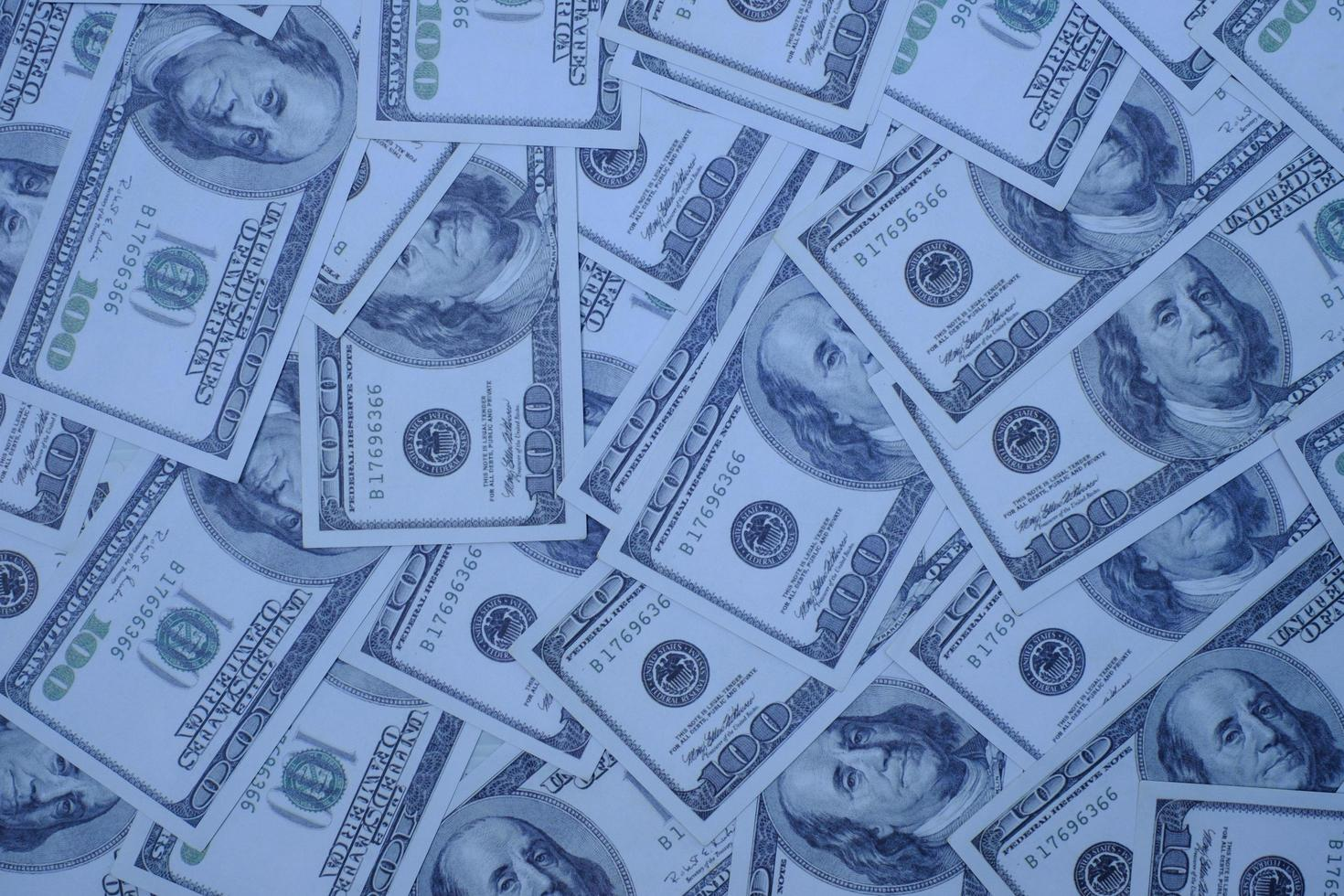 groupe d'argent pile de billets de 100 dollars américains beaucoup de la texture d'arrière-plan photo