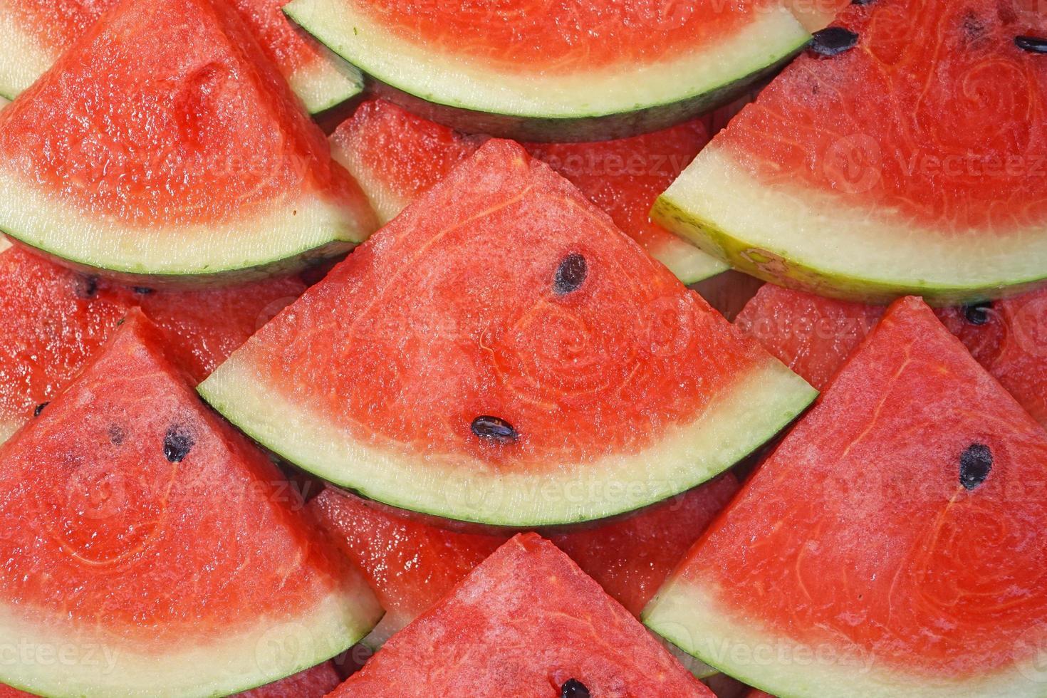 morceaux de pastèque fraîche en arrière-plan photo