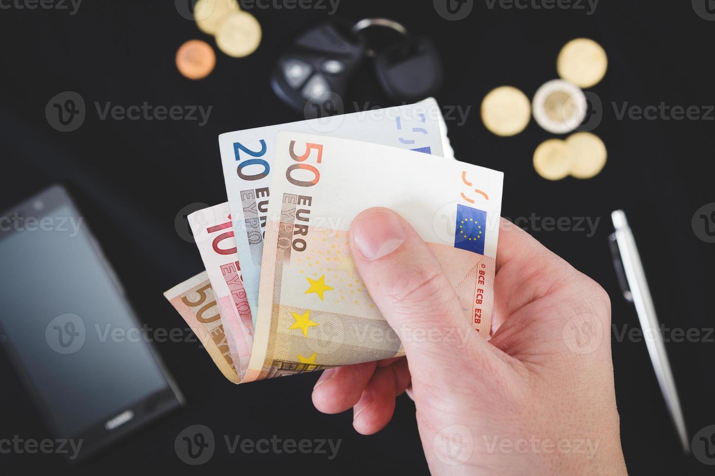 Mans main tenant de l'argent photo