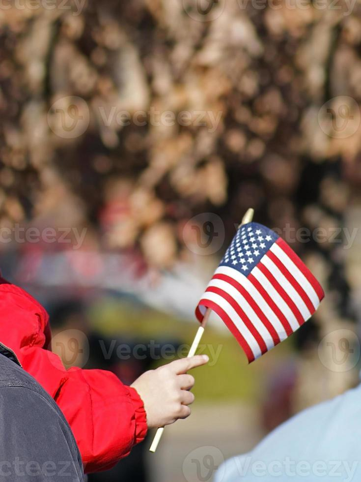 Childs hand holding flag photo