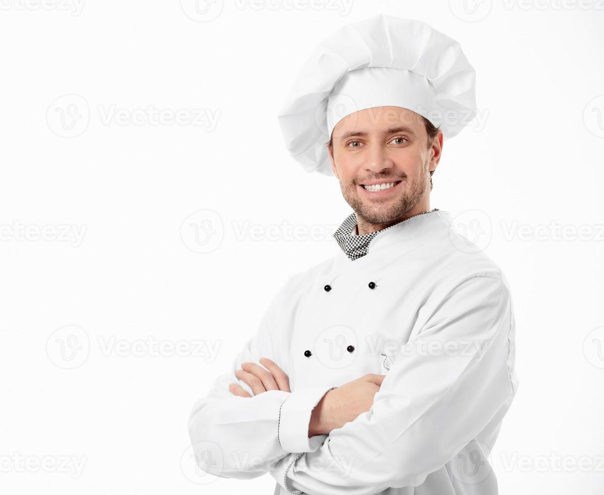 un cuisinier souriant avec ses bras croisés photo