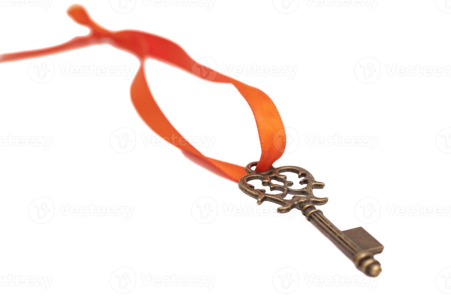 clé du succès rouge avec arc rouge photo
